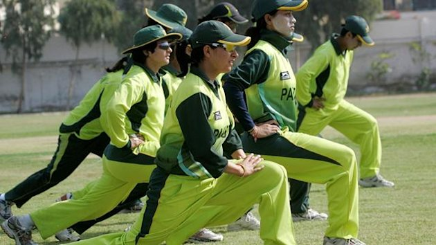 Pakistan women players warm up during a training session in Karachi February 27, 2009. While their male counterparts are idolised and earn millions, women's cricket in Pakistan is still an amateur sport. Playing opportunities and training facilities are s