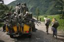 In this November 30, 2012 photo, M23 rebels withdraw from the Masisi and Sake areas in eastern Congo. THE CANADIAN PRESS/AP, Jerome Delay