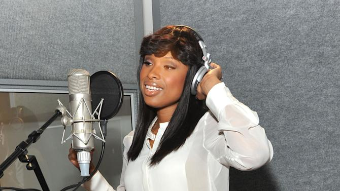 """COMMERCIAL IMAGE - In this photo released by Pampers on Thursday, June 28, 2012, Jennifer Hudson teams with Pampers to create her rendition of the classic """"Lullaby and Goodnight"""" during a recording session in New York.  Hudson recorded the revered lullaby for exclusive free download at Pampers Facebook page, www.Facebook.com/Pampers, to honor the joyful way that parents bond with their little ones through music.  (Photo by Diane Bondareff/Invision for Pampers/AP Images)"""