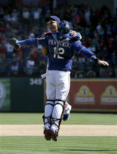 Rangers clinch series over A's with 4-3 win