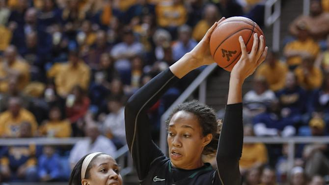 Baylor's Brittney Griner (42) works against West Virginia's Ayana Dunning (33) during the first half of an NCAA college basketball game at WVU Coliseum in Morgantown, W.Va., on Saturday, March 2, 2013. (AP Photo/David Smith)