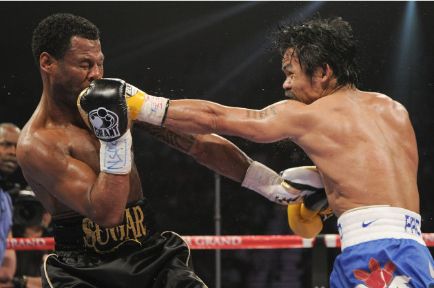Manny Pacquiao, right, lands a punch against Shane Mosley in the fifth round during a WBO welterweight title bout, Saturday, May 7, 2011, in Las Vegas.  (AP Photo/Mark Terrill)