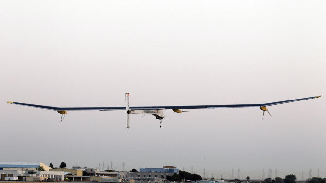 The Solar Impulse plane takes off on a multi-city trip across the United States from Moffett Field NASA Ames Research Center in Mountain View, Calif., Friday, May 3, 2013. Solar Impulse, considered the world's most advanced solar-powered plane, will stop for seven to 10 days at major airports in each city, so the pilots can display and discuss the aircraft with reporters, students, engineers and aviation fans. It plans to reach New York's Kennedy Airport in early July — without using a drop of fuel, its creators said. (AP Photo/Tony Avelar)