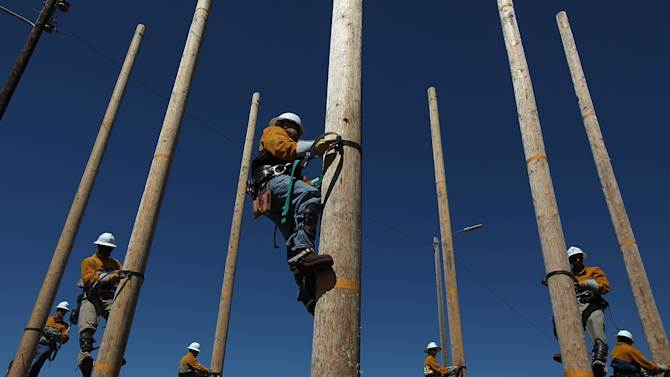 Utility Worker Trainees Learn Pole-Climbing Skills