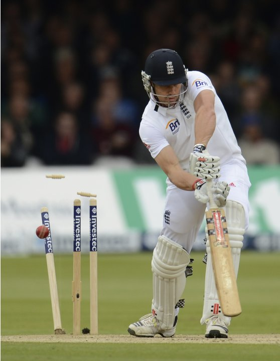 England's Compton is bowled by Neil Wagner for 15 runs during the first test cricket match at Lord's cricket ground in London