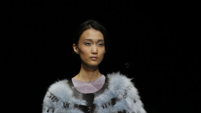 A model wears a creation for Giorgio Armani women's Fall-Winter 2015-16 collection, part of Milan Fashion Week, unveiled in Milan, Italy, Monday, March 2, 2015. (AP Photo/Luca Bruno)