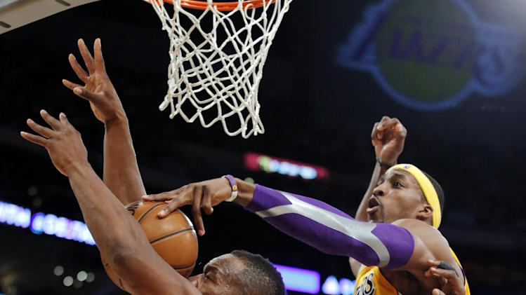 Indiana Pacers' Sam Young, left, gets his shot blocked by Los Angeles Lakers' Dwight Howard in the first half of an NBA basketball game in Los Angeles, Tuesday, Nov. 27, 2012. (AP Photo/Jae C. Hong)