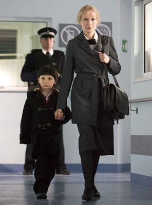 Seamus Davey-Fitzpatrick as Damien and Mia Farrow as Mrs. Baylock in 20th Century Fox's The Omen