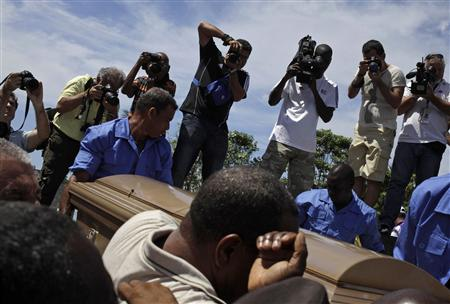 People carry the coffin of Cuban boxing great Teofilo Stevenson, during his funeral in Havana