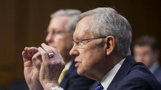 """Senate Majority Leader Harry Reid of Nev., right, accompanied by Senate Minority Leader Sen. Mitch McConnell of Ky., testifies on Capitol Hill in Washington, Tuesday, June 3, 2014, before the Senate Judiciary Committee hearing on """"examining a constitutional amendment to restore democracy to the American people"""". The Democratic-led Senate Judiciary Committee on Tuesday began a long-shot bid at a constitutional amendment that would limit deep-pocketed political campaign donors' influence. (AP Photo/Manuel Balce Ceneta)"""