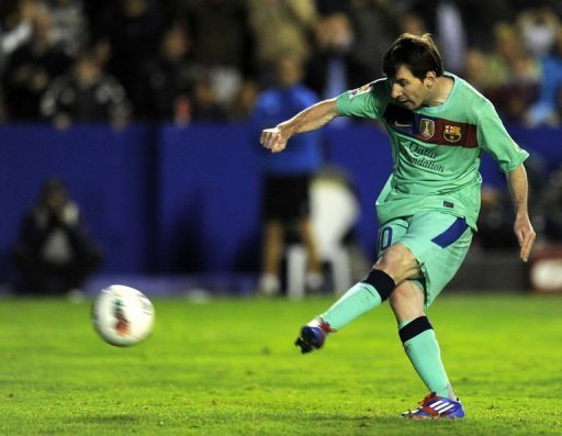 Barcelona's forward Lionel Messi scores a goal