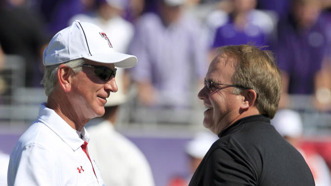 TCU head coach Gary Patterson, right, and Texas Tech head coach Tommy Tuberville chat as their teams warm up before an NCAA college football game, Saturday, Oct. 20, 2012, in Fort Worth. (AP Photo/LM Otero)