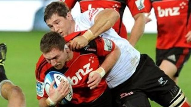 Crusaders' Kieran Read is tackled by Sharks' Willem Alberts in the Super Rugby match at Trafalgar Park, Nelson, New Zealand, Saturday, June 25, 2011