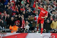 Liverpool's Andy Carroll celebrates scoring during their FA Cup final football match against Chelsea at Wembley Stadium in London. Chelsea won 2-1