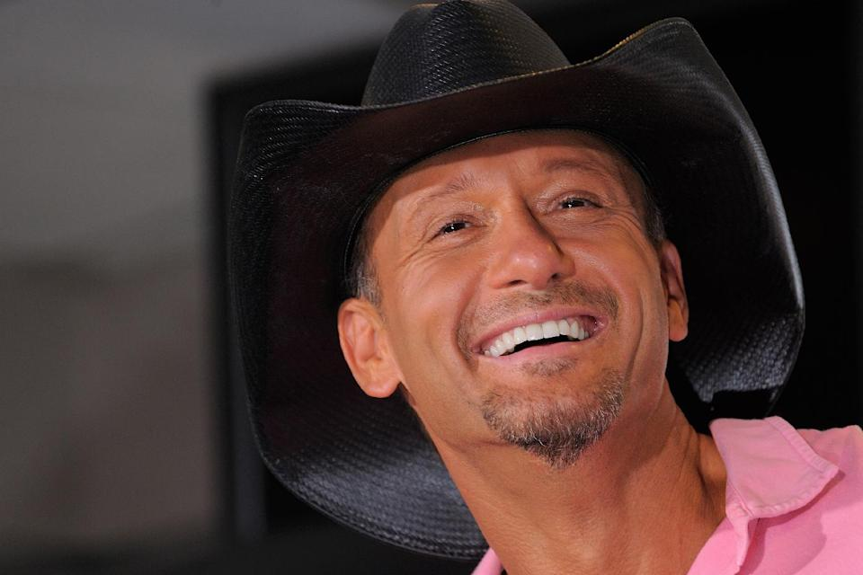 "Country singer Tim McGraw appears at a news conference to promote his ""Brothers of the Sun"" concert tour on Friday June 1, 2012 in Tampa, Fla. McGraw and fellow country singer Kenny Chesney will kick off their joint tour on Saturday night in Tampa, Fla. (Photo by Scott Miller/Invision/AP)"