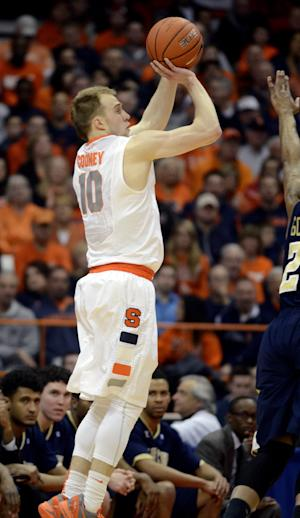 Syracuse's Trevor Cooney shoots against Georgia Tech during the first half of an NCAA college basketball game in Syracuse, N.Y., Tuesday, March 4, 2014. (AP Photo/Kevin Rivoli)