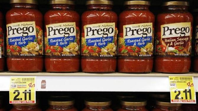 Jars of Prego pasta sauce line the shelves at a local grocery store in Golden