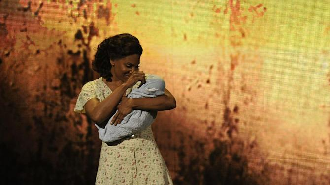 "Audra McDonald performs a scene from ""The Gershwins' Porgy and Bess"" at the 66th Annual Tony Awards on Sunday June 10, 2012, in New York. The production won a Tony Award for best revival of a musical. (Photo by Charles Sykes /Invision/AP)"