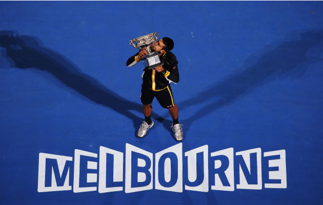 Novak Djokovic of Serbia poses with the Norman Brookes Challenge Cup after defeating Andy Murray of Britain in their men's singles final match at the Australian Open tennis tournament in Melbourne