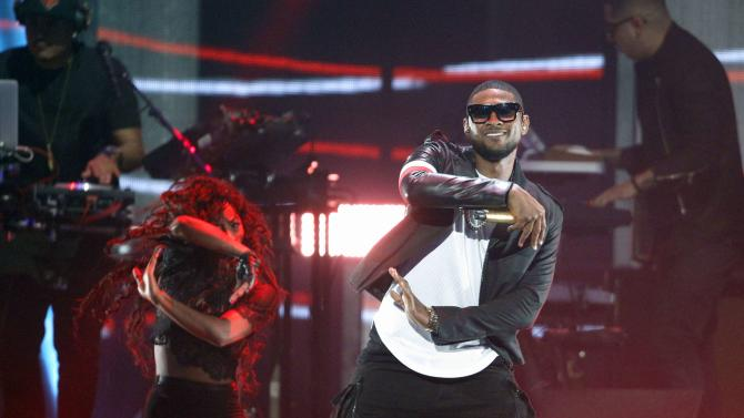 Usher performs during the 2014 iHeartRadio Music Festival in Las Vegas, Nevada