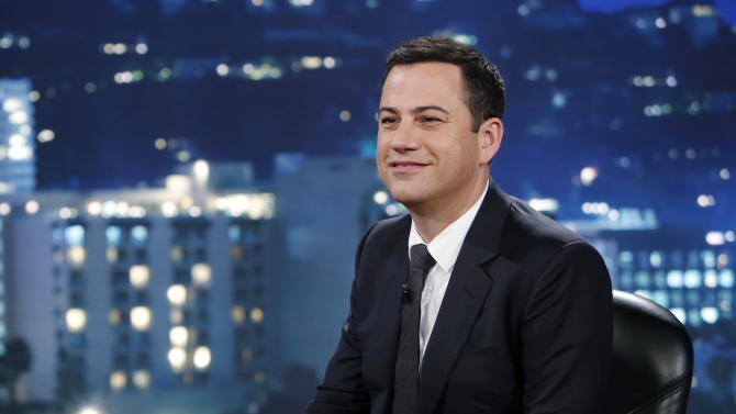 """This July 3, 2013 photo released by ABC shows Jimmy Kimmel on """"Jimmy Kimmel Live"""" ABC's late-night host conducted what is becoming an annual prank during the past week, encouraging parents to tell their children that they had eaten all of their Halloween candy, film the response and upload the video so he can show them on his TV show and on YouTube. Since starting the feature in 2011, Kimmel's show said the post-Halloween videos have been viewed more than 106 million times online. (AP Photo/ABC, Randy Holmes, File)"""