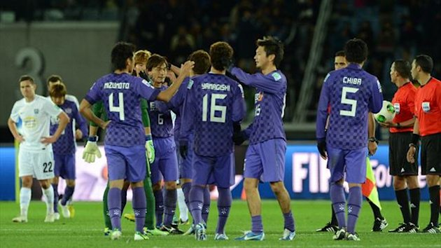 Sanfrecce Hiroshima players celebrate their victory over Auckland City at the FIFA Club World Cup 2012 (AFP)