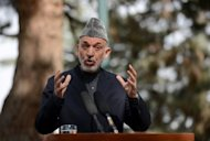Afghan President Hamid Karzai speaks to journalists during a press conference on October 18. Karzai's re-election in 2009 was marred by widespread allegations of fraud, and the credibility of the next vote is seen as key to avoiding an escalation in violence after the NATO withdrawal