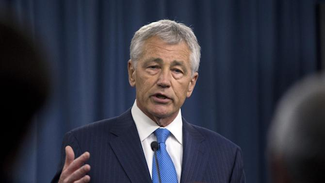 New Defense Secretary Chuck Hagel gestures as he speaks at a news conference regarding the automatic spending cuts, Friday, March 1, 2013, at the Pentagon. (AP Photo/Carolyn Kaster)