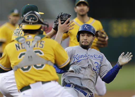 Adam Rosales' go-ahead homer lifts A's past Royals