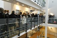 Accredited members of the press wait in line for a final security check in the court house in Oslo Monday Nov. 14, 2011 before the hearing for Anders Behring Breivik. Breivik has admitted killing 77 people on July 22. (AP Photo/Scanpix, Berit Roald) NORWAY OUT