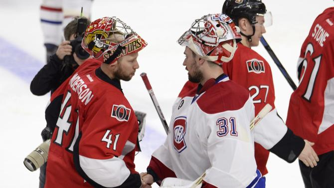 Montreal Canadiens goalie Carey Price (31) and Ottawa Senators goalie Craig Anderson (41) shake hands following Game 6 of a first-round NHL hockey playoff series Sunday April 26, 2015, in Ottawa, Ontario. The Canadiens defeated the Senators 2-0 to advance to the second round of the NHL playoffs. (Adrian Wyld/The Canadian Press via AP) MANDATORY CREDIT