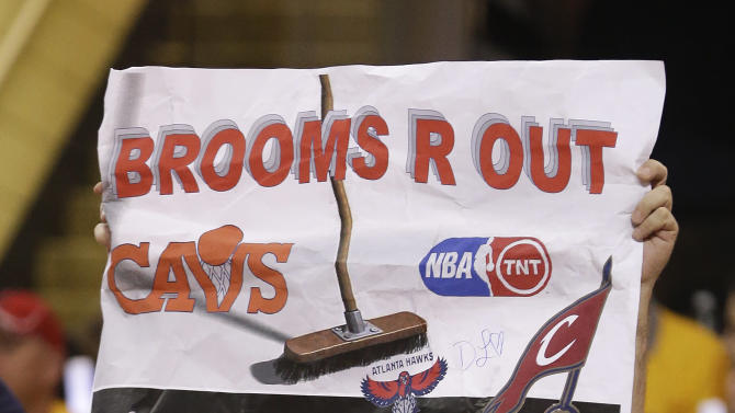 A Cleveland Cavaliers fan holds up a sign in the first half of Game 4 of the NBA basketball Eastern Conference Finals against the Atlanta Hawks, Tuesday, May 26, 2015, in Cleveland. (AP Photo/Tony Dejak)