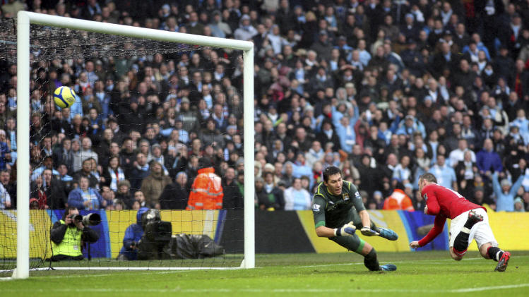Manchester United's Wayne Rooney, right, scores a goal past Manchester City's goalkeeper Costel Pantilimon, left, during their FA Cup third round soccer match at the Etihad stadium, Manchester, England, Sunday, Jan. 8, 2012. (AP Photo/Scott Heppell)