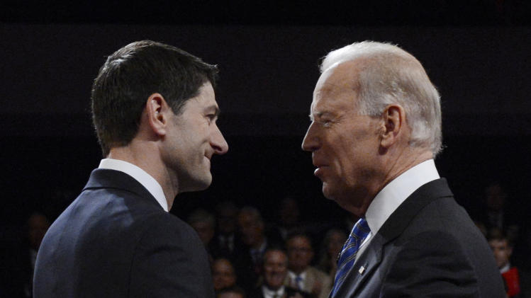 Vice President Joe Biden and Republican vice presidential nominee Paul Ryan of Wisconsin shake hands before the vice presidential debate at Centre College, Thursday, Oct. 11, 2012, in Danville, Ky. (AP Photo/Pool-Michael Reynolds)