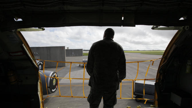 In this Aug. 14, 2012 photo, ground crew member Senior Airman George Snyder, of San Antonio, Texas, stands inside a U.S. Air Force KC-135 Stratotanker, which was built in 1958, at Kadena Air Base on Japan's southwestern island of Okinawa. For decades, the U.S. Air Force has grown accustomed to such superlatives as unrivaled and unbeatable. Now some of its key aircraft are being described with terms like decrepit.   (AP Photo/Greg Baker)