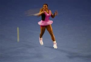 Serena Williams of the United States hits a return to Ashleigh Barty of Australia during their women's singles match at the Australian Open 2014 tennis tournament in Melbourne