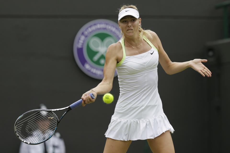 Maria Sharapova of Russia plays a return to Tsvetana Pironkova of Bulgaria during a second round women's singles match at the All England Lawn Tennis Championships at Wimbledon, England, Thursday, June 28, 2012. (AP Photo/Sang Tan)