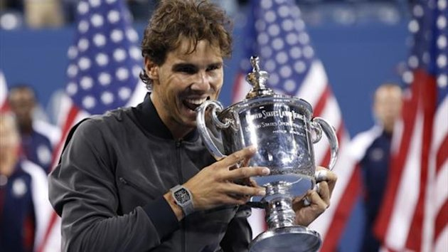 Rafael Nadal of Spain bites his trophy after defeating Novak Djokovic of Serbia in the US Open final (Reuters)