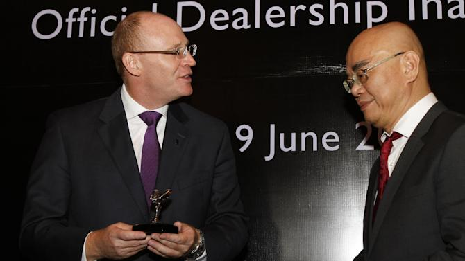Rolls-Royce Asia-Pacific regional manager Paul Harris, left, speaks to HGB Group Co. Ltd. managing director Ray Long during the inauguration of Rolls-Royce's official dealership in Phnom Penh, Cambodia, Monday, June 9, 2014. Rolls-Royce Motor Cars announced Monday that it has joined with the Cambodian business partner HGB to open a showroom in the Cambodian capital next month. (AP Photo/Heng Sinith)