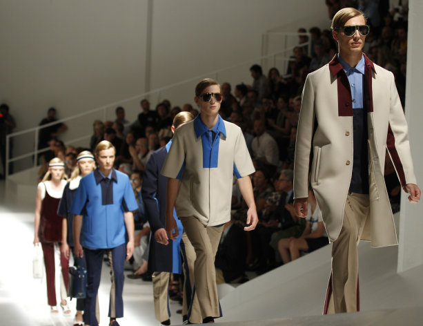Models wear creations of Prada, from the men's Spring-Summer 2013 collection, part of the Milan Fashion Week, unveiled in Milan, Italy, Sunday, June 24, 2012. (AP Photo/Luca Bruno)