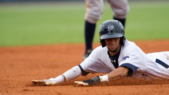 Billy Hamilton #4 of the Pensacola Blue Wahoos slides safely into third base as against the Montgomery Biscuits at Community Maritime Park Stadium on August 19, 2012 in Pensacola, Florida. Billy Hamilton is set to break the minor league record of 145 stolen bases currently held by Vince Coleman of Macon Redbird's 1983 team. (Photo by Michael Chang/Getty Images)