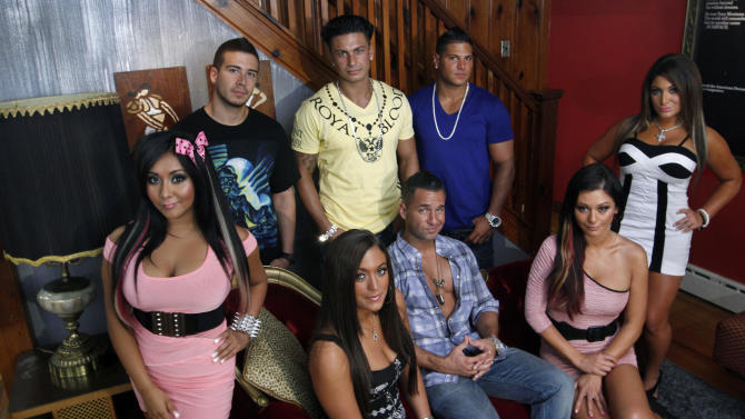"""FILE  - An Aug. 4, 2011 file photo shows the cast members of MTV's """"Jersey Shore"""" at their television home in Seaside Heights, N.J.   Fans of sthe television show can rent the house for $2.500 a night.  (AP Photo/Mel Evans/file)"""