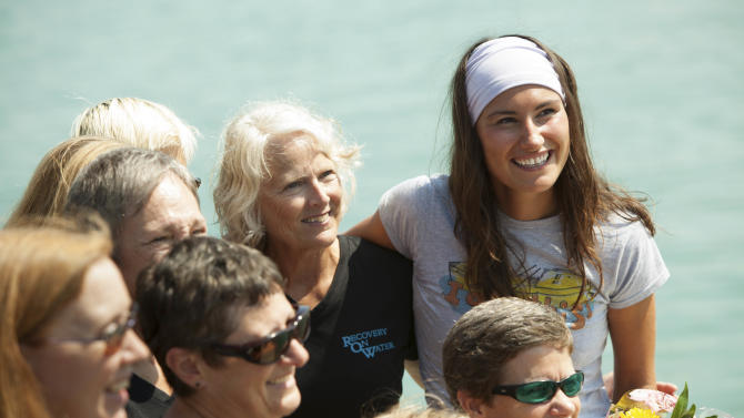Jenn Gibbons, top right, poses for a photo with members of Recovery on Water (ROW), a rowing team of cancer survivors she coaches on Tuesday, Aug. 14, 2012 in Chicago. The trip helped 27-year-old Gibbons raise $113,000 for ROW. (AP Photo/Sitthixay Ditthavong)