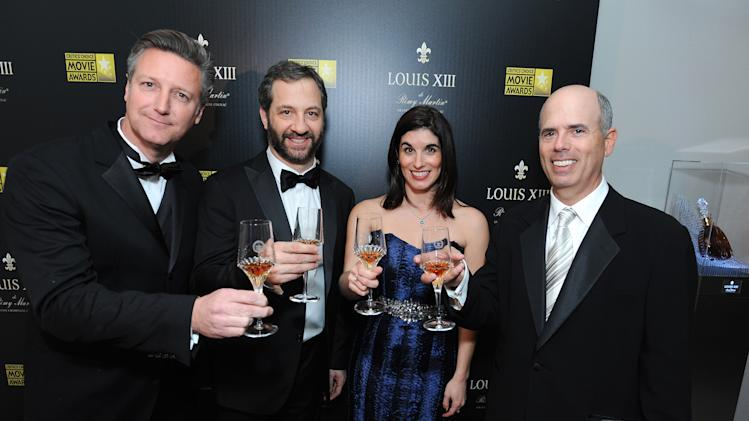 IMAGE DISTRIBUTED FOR LOUIS XIII - From left, Yves DeLaunay, Judd Apatow, Nila Vermiglio and Joey Berlin toast Judd Apatow's Critics' Choice LOUIS XIII Genius Award at Barker Hangar on Thursday, January 10, 2013 in Santa Monica, Calif. (Photo by Jordan Strauss/Invision for LOUIS XIII/AP Images)