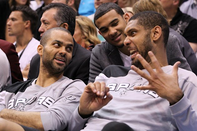 San Antonio Spurs&#39; Tony Parker, left, of France, Tim Duncan, right, and Cory Joseph, center, joke on the bench late in the second half of Game 4 in the first-round NBA basketball playoff series against the Utah Jazz, Monday, May 7, 2012, in Salt Lake City. The Spurs defeated the Jazz 87-81 to take the series 4-0. (AP Photo/Colin E Braley)