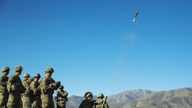 A mortar flies out of a tube during a mortar exercise for U.S. soldiers in Dragon Company of the 3rd Cavalry Regiment near forward operating base Gamberi in the Laghman province of Afghanistan