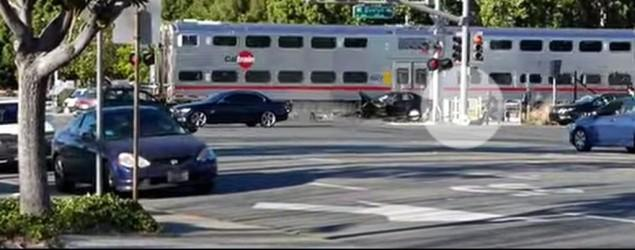 Cop drags man out of train's path at last second