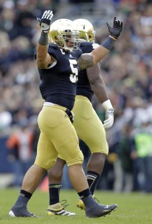 Notre Dame linebacker Manti Te'o celebrates after an interception against the BYU during the first half of an NCAA college football game in South Bend, Ind., Saturday, Oct. 20, 2012. (AP Photo/Michael Conroy)