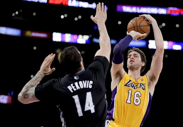 Los Angeles Lakers center Pau Gasol shoots over Minnesota Timberwolves center Nikola Pekovic during the first half of an NBA basketball game in Los Angeles, Friday, Dec. 20, 2013