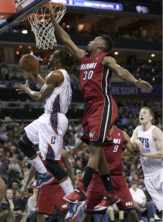 James lifts Heat over Bobcats 104-96 in OT